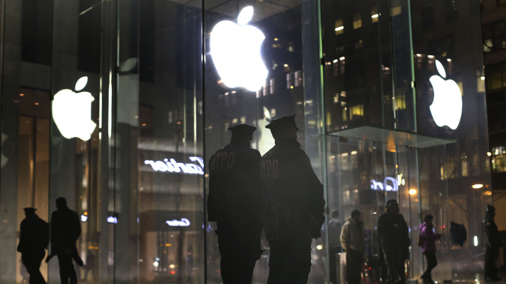 New York police officers stand outside the Apple Store on Fifth Avenue while monitoring a demonstration in New York.