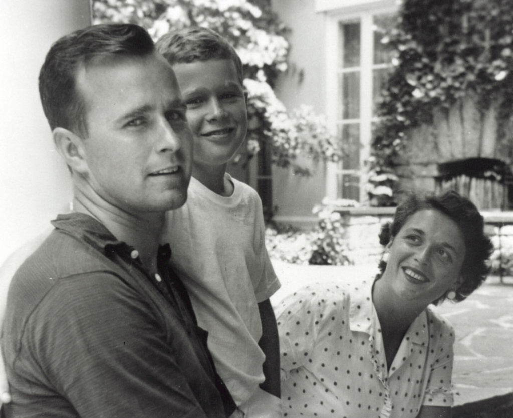 George W. Bush (center) poses with father George Bush and his mother Barbara Bush in Rye, New York, summer 1955.