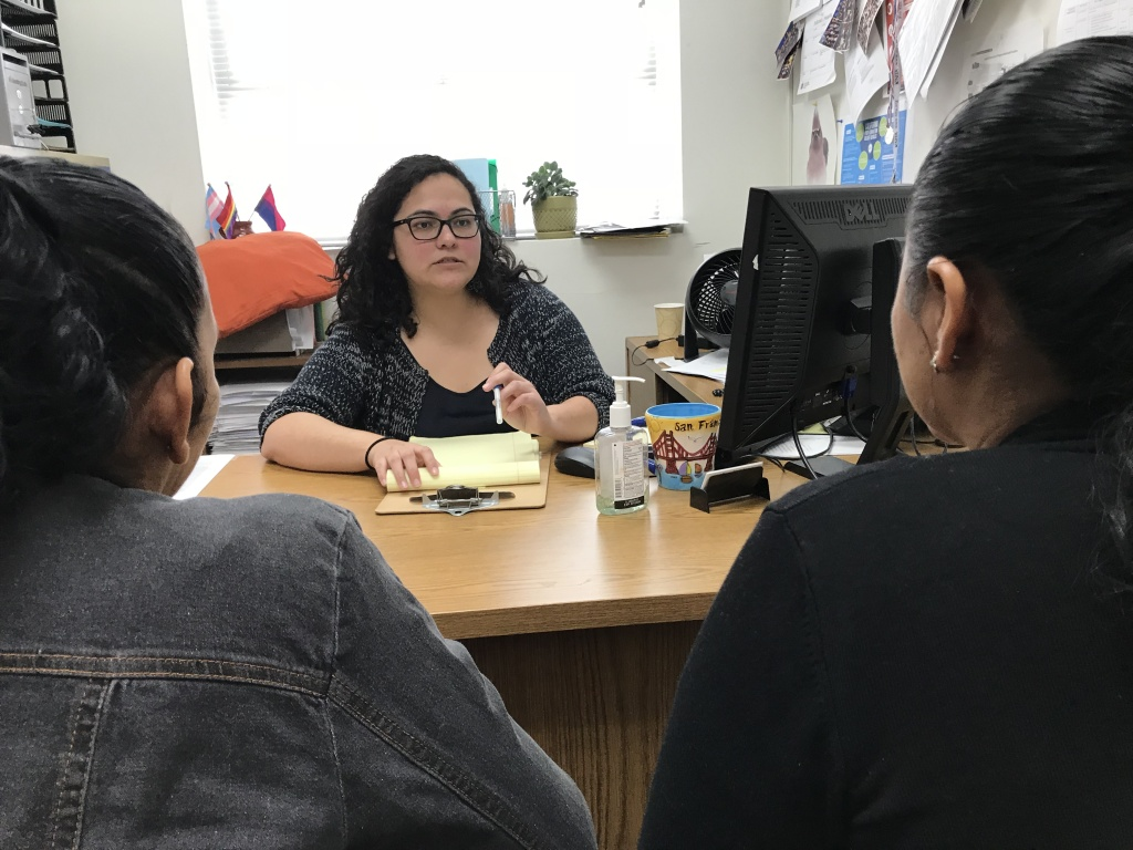 Patricia Ortiz meets with Rosa at the Esperanza Immigrant Rights Project offices in Los Angeles to discuss her asylum case, Dec. 5, 2018.