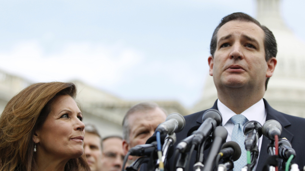 Sen. Ted Cruz, R-Texas, accompanied by Rep. Michele Bachmann, R-Minn., speaks during a news conference with Tea Party leaders on May 16. Bachmann, chairwoman of the Tea Party Caucus, announced this week she won't seek re-election. Meanwhile, Cruz's fortunes continue to soar.