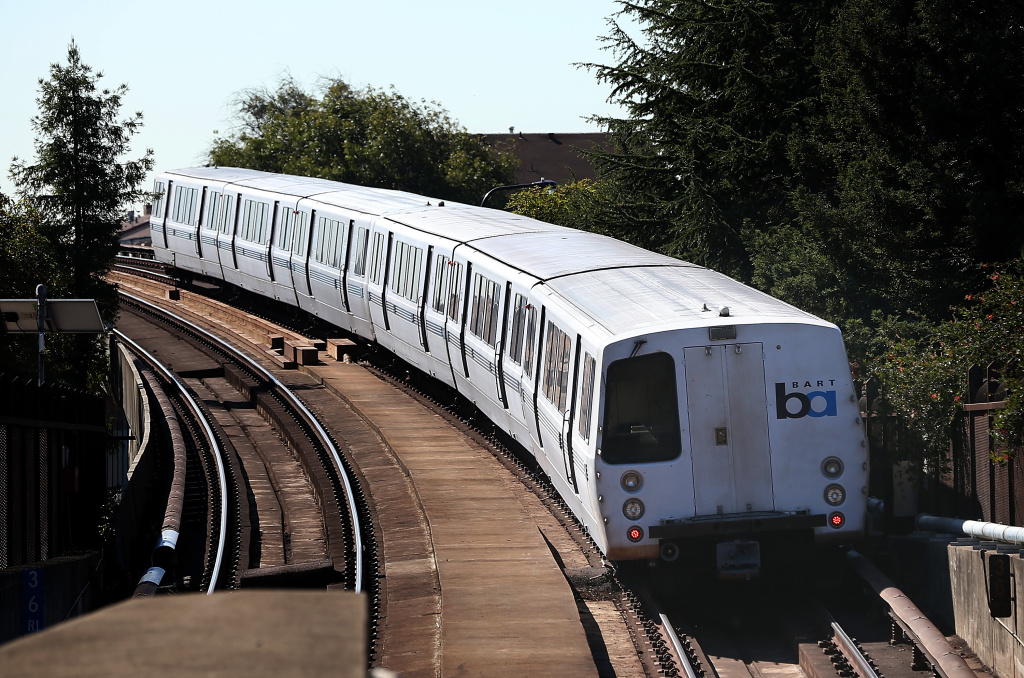 A Bay Area Rapid Transit (BART) train emerges from a tunnel on in Berkeley, California.