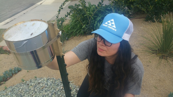 UC Berkeley PhD student Diane Garcia-Gonzales takes readings from a monitor placed in the front yard of a Porter Ranch home. Garcia-Gonzales is one of the student volunteers helping UCLA Environmental Health Scientist Michael Jerrett take independent air samples at the site of the Southern California Gas Company leak at its Aliso Canyon storage facility.