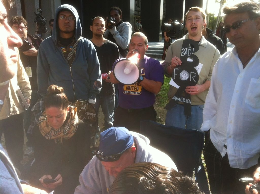 Demonstrators from Good Jobs LA and Occupy LA picket a foreclosure auction on Friday