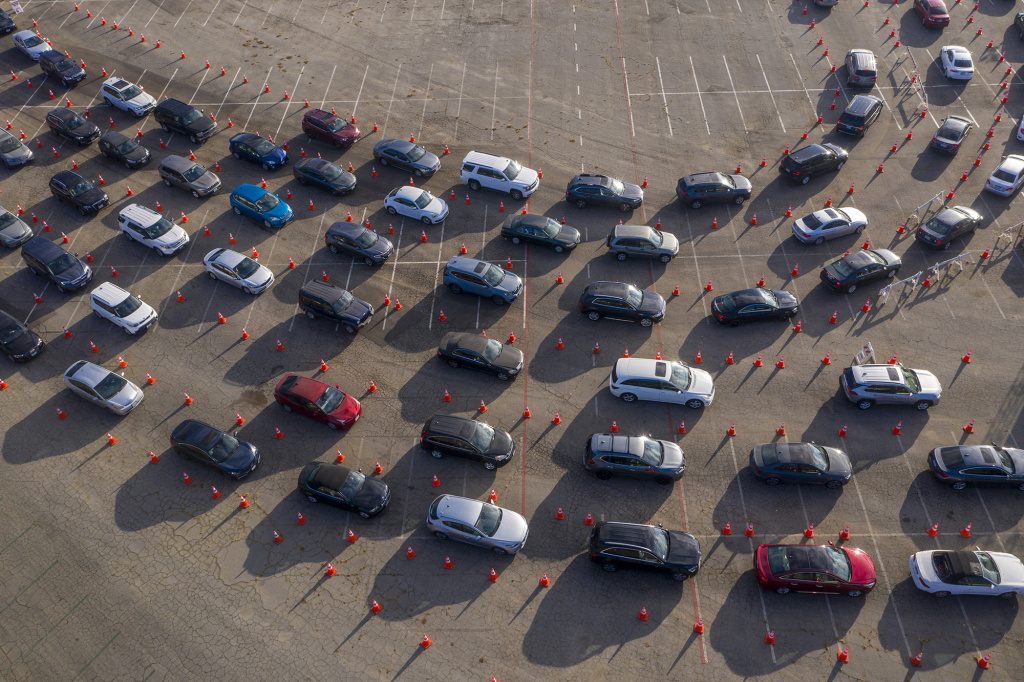 In an aerial view from a drone, cars line up at Dodger Stadium for COVID-19 testing in Los Angeles, California.