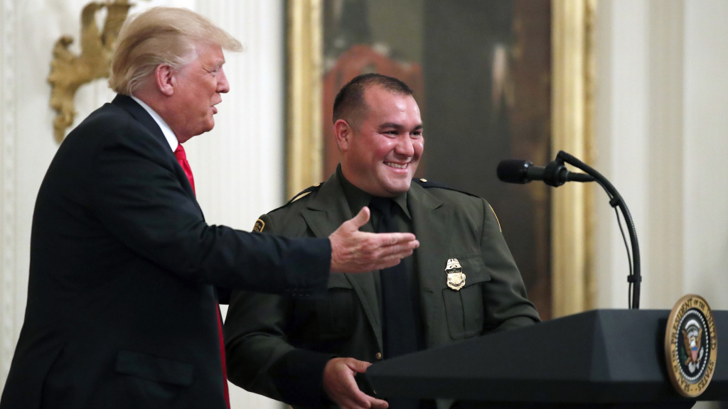 President Trump with Customs and Border Patrol agent Adrian Anzaldua, whom he praised for finding around 80 immigrants in a tractor trailer.