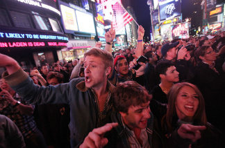 New Yorkers react to the death of Osama bin Laden as they gathered in Times Square, earlier this week.