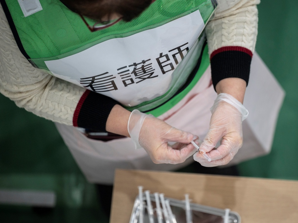 A nurse prepares syringes for a coronavirus vaccination drill in Kawasaki on Jan. 27, 2021.