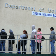 People wait in line outside of the State of California Department of Motor Vehicles in Los Angeles, Calif. on February 13, 2009. As of this week, immigrants without legal status may make appointments with the DMV for January to apply for a special California driver's license under the new law known as AB 60, which takes effect after the start of the year.