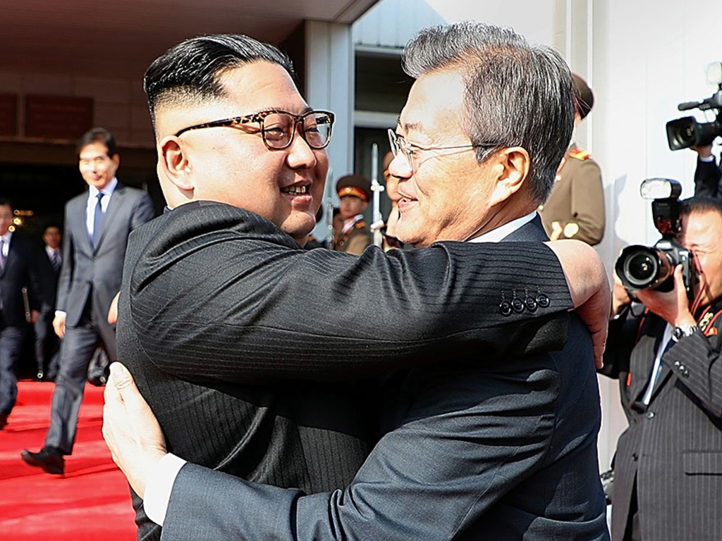 North Korean leader Kim Jong Un (left) and South Korean President Moon Jae-in embrace before their meeting on Saturday on the North Korean side of the shared inter-Korean area of Panmunjom.
