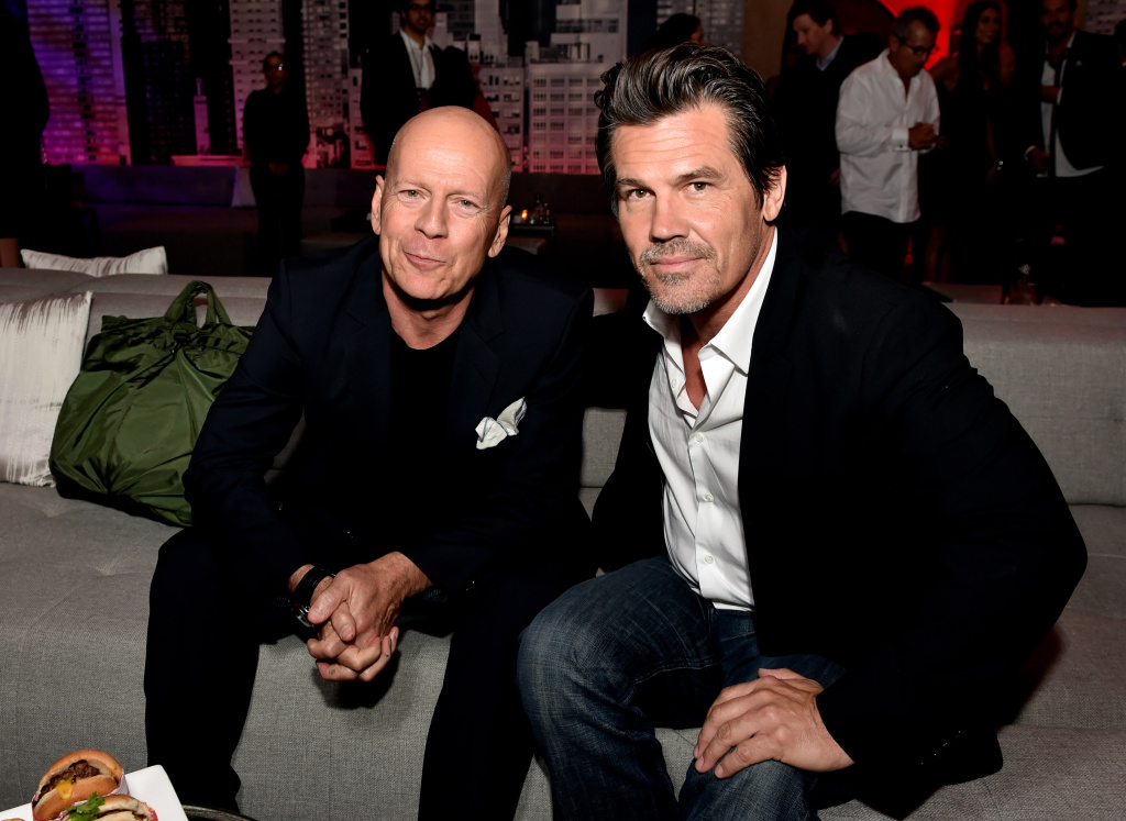 Actors Bruce Willis (L) and Josh Brolin pose at the after party for the premiere of Dimension Films'