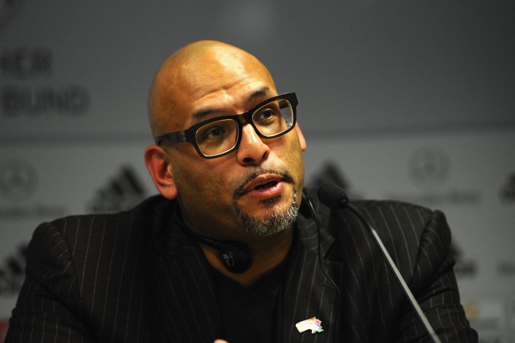 Former NBA player John Amaechi speaks during a press conference at the DFB Dialog Forum 'Vor dem Ball sind alle gleich - Sexuelle Identitaeten im Fussball' about sexual identities in football at Sportschule Hennef on January 17, 2012 in Hennef, Germany.