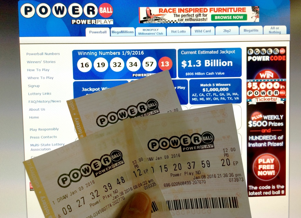 Photo illustration shows Powerball lottery tickets in front of the splash screen for the powerball.com website.
