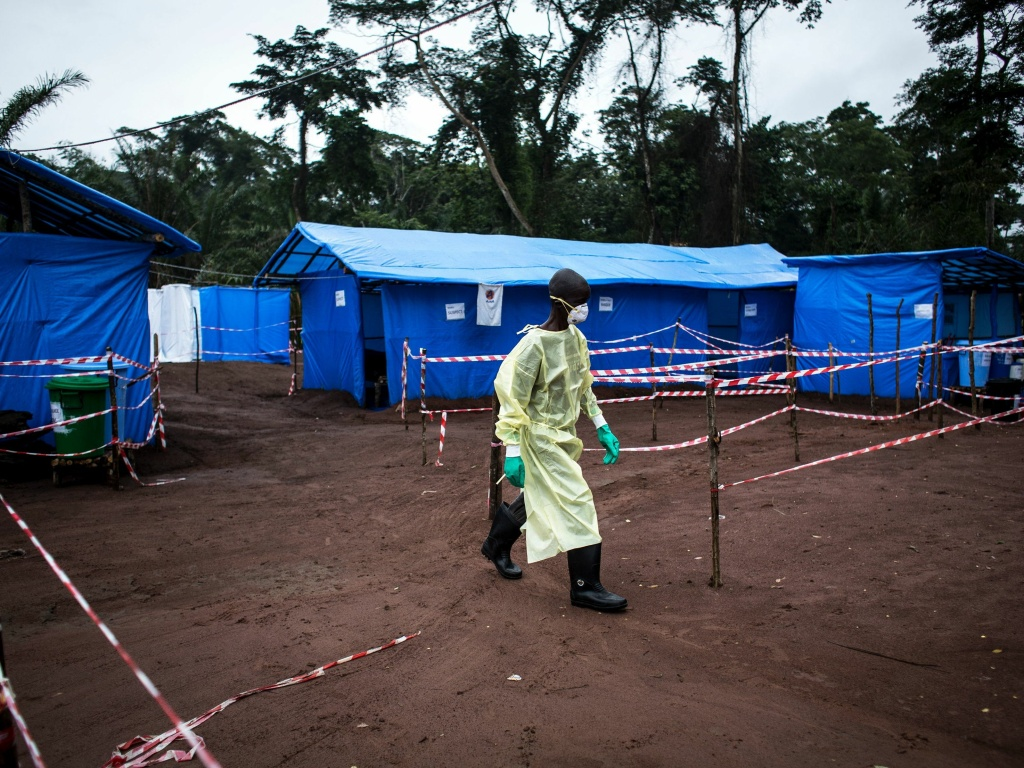 A health worker walks at an Ebola quarantine unit last June in Muma, Democratic Republic of the Congo, after a case of Ebola was confirmed in the village.