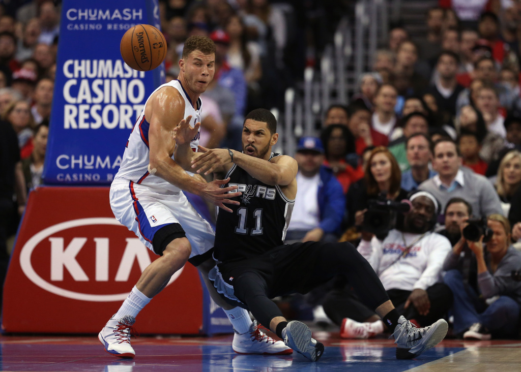 Jeff Ayres #11 of the San Antonio Spurs loses control of the ball while defended by Blake Griffin #32 of the Los Angeles Clippers in the first half at Staples Center on February 18, 2014 in Los Angeles, California.