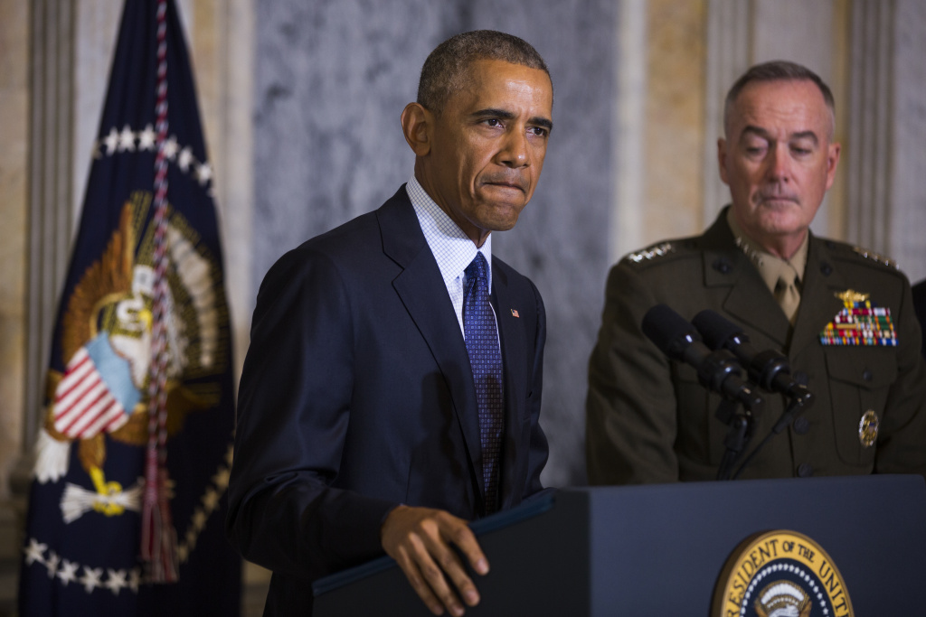 US President Barack Obama (L) speaks on the Orlando shooting at the Treasury Department while Chairman of the Joint Chiefs of Staff General Joseph Dunford (R) look on, on June 14, 2016.