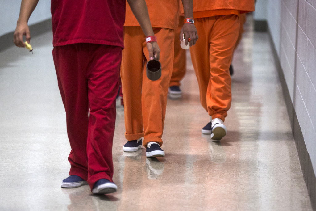 FILE: Detainees are taken back to their dorms after lunch at the U.S. Immigration and Customs Enforcement's immigrant detention facility in Adelanto on Friday, Sept. 2, 2016.