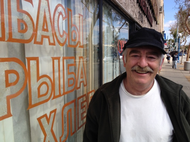 Edward Kessler stands outside Odessa Market in West Hollywood, which is frequented by many Russian speakers. Most said they are closely following the Sochi Winter Olympics in Russia.