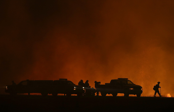 A firefighter monitors a backfire as he battles the King Fire on September 17, 2014 in Fresh Pond, California. The King fire is threatening over 1,600 homes in the forested area about an hour east of Sacramento and has consumed over 18,544 acres. The out of control fire is 5 percent contained.