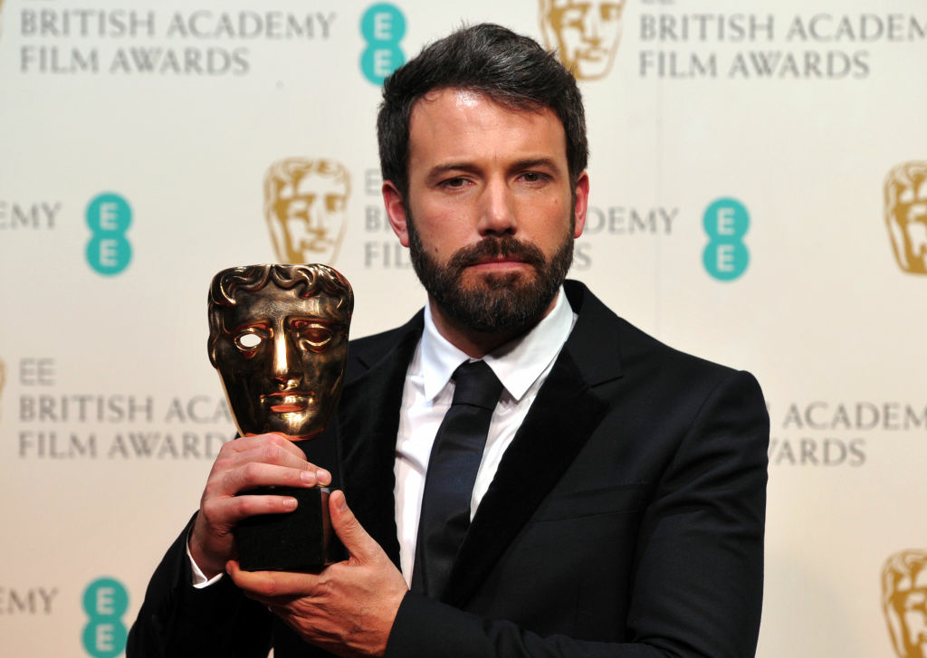 US actor and director Ben Affleck poses with Best Director award for his film Argo during the annual BAFTA British Academy Film Awards at the Royal Opera House in London on February 10, 2013.