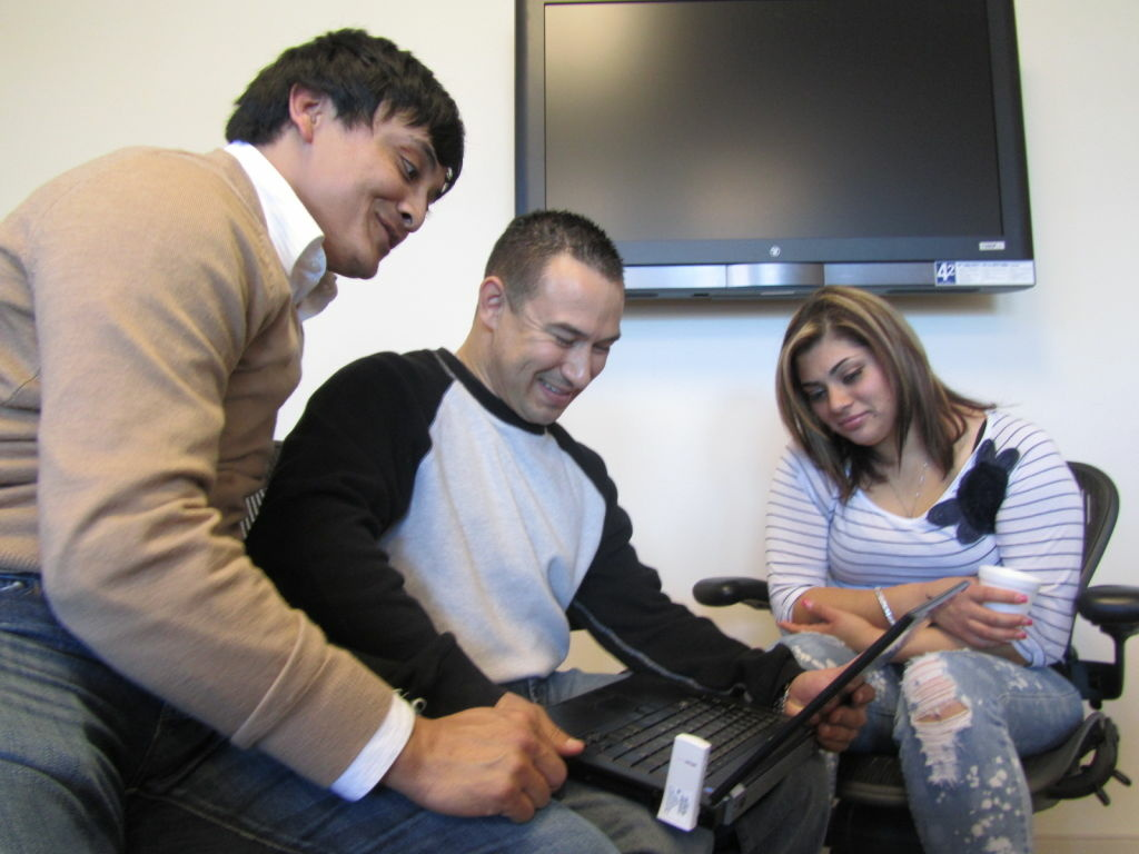 Antonio Rivera (left) shows Roy Arredondo and his girlfriend, Angie Facebook pictures of his little brother, Darwin Rivera.  The 22-year-old was killed in a motorcycle accident in August, 2010.  Arredondo received one of his kidneys.