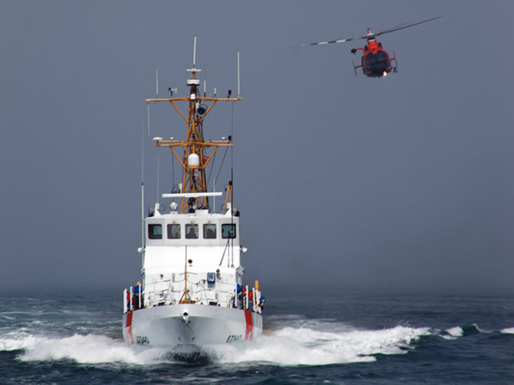 A Coast Guard crew similar to the one in this file photo discovered 80 bales of marijuana aboard a sailboat beached in Newport Harbor early Monday. The crew of the sailboat fled. (AP Photo/U.S. Coast Guard/Steve Lee)