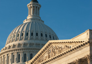 The sun rises on the US Capitol Dome on the US Senate side early December 24, 2009, in Washington, DC. File photo.