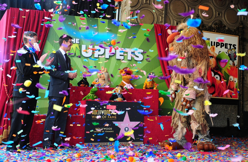 Rich Ross, Walt Disney Studios President, and Leron Gubler, President and CEO of the Hollywood Chamber of Commerce, unveil the Muppets Star on Hollywood's Walk of Fame. Ross was ousted as head of Disney's movie studio last Friday.