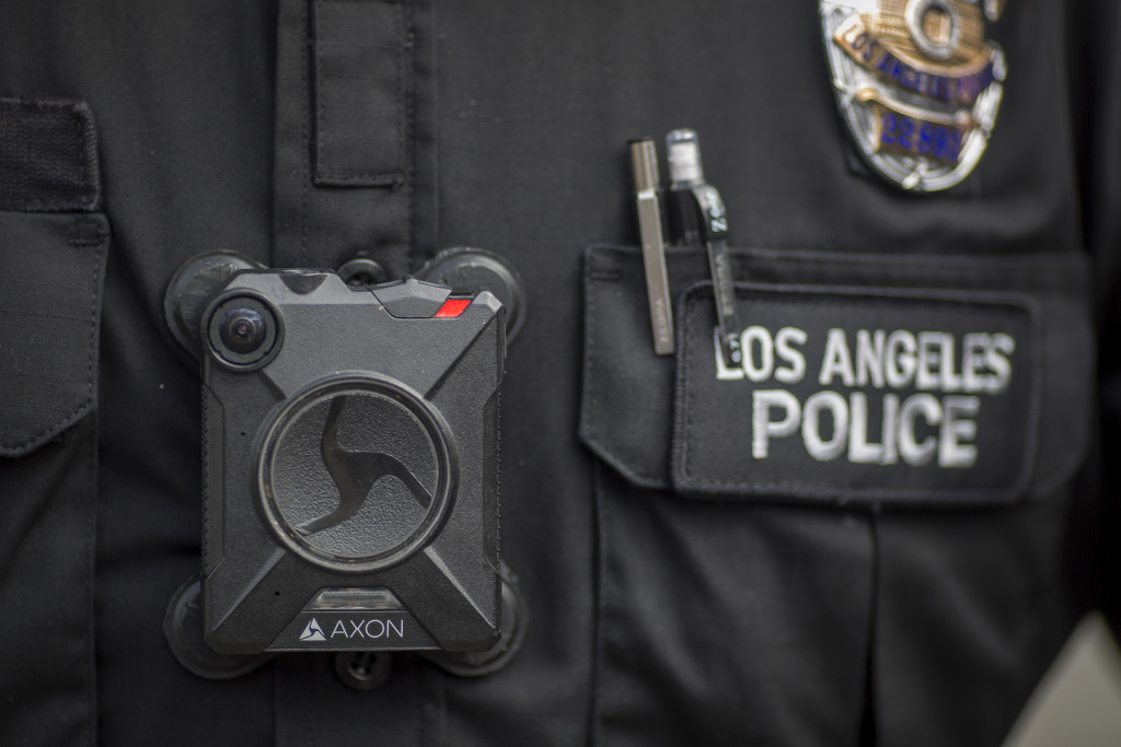 A Los Angeles police officer wear an AXON body camera during the Immigrants Make America Great March to protest actions being taken by the Trump administration on February 18, 2017.