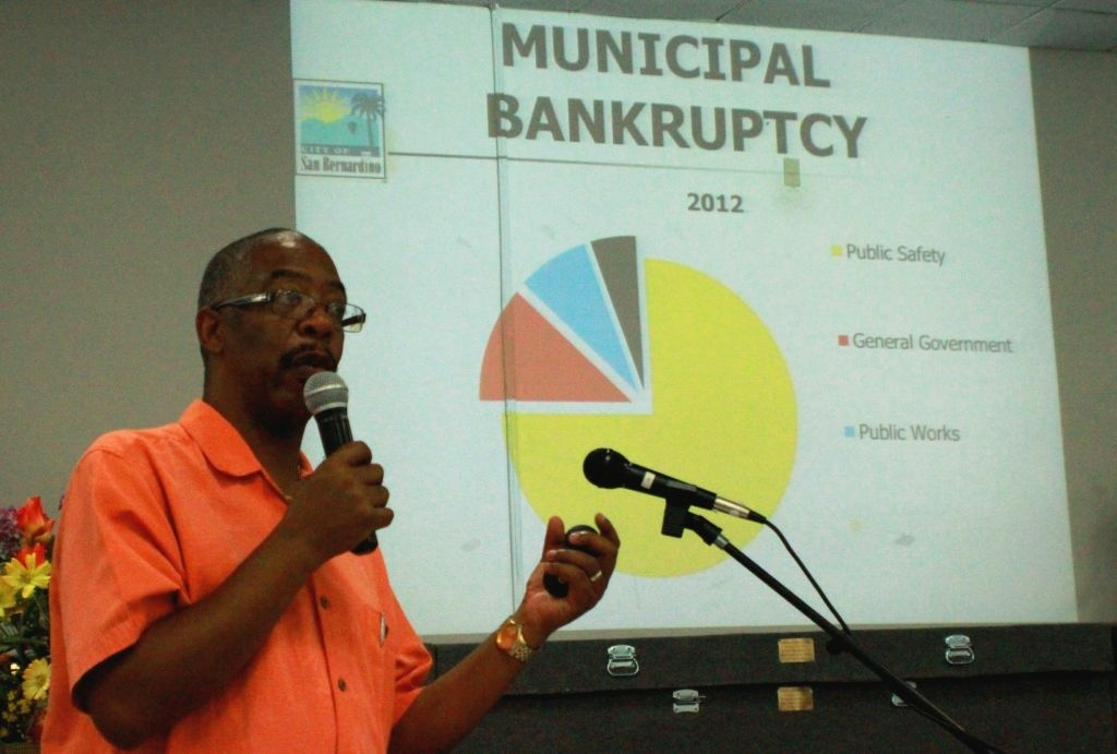 San Bernardino Councilman Rikke Van Johnson explains municipal bankruptcy process at a town hall meeting in late June.