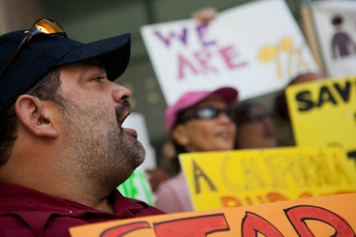 Daniel Garcia joins protesters in railing against Gov. Jerry Brown's May revise budget in Downtown Los Angeles on May 14, 2012.