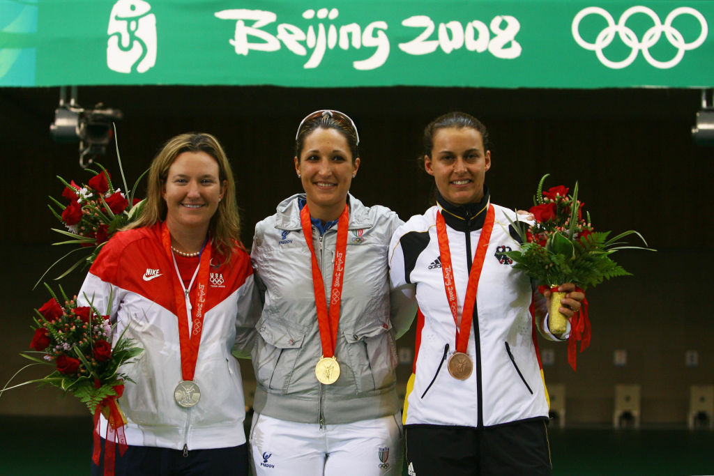 Silver medalist Kimberly Rhode of the United States, gold medalist Chiara Cainero of Italy and bronze medalist Christine Brinker of Germany pose with their medals after the Women's Skeet Final at the Shooting Range CTF during Day 6 of the Beijing 2008 Olympic Games on August 14, 2008 in Beijing, China.