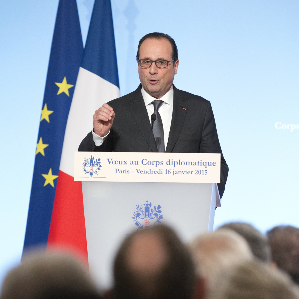French President Francois Hollande gestures as he delivers a speech to foreign ambassadors during a ceremony to extend New Year wishes at the Elysee Palace in Paris, on Friday.