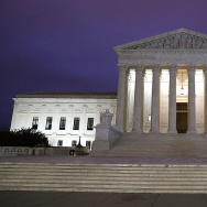 A man walks up the steps of the U.S. Supreme Court on Tuesday.
