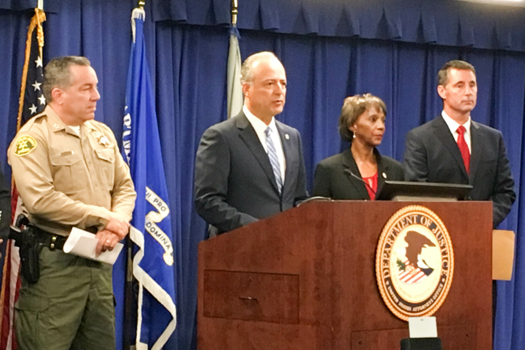 U.S. Attorney Nicola Hanna (center), along with (from left to right) Sheriff Alex Villanueva, L.A. District Attorney Jackie Lacey and FBI agent Paul Delacourt, announces the indictment of 22 members of the MS-13 gang.