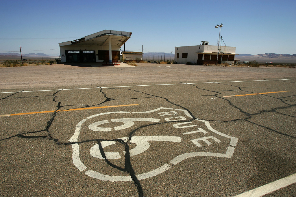 A symbol based on the original Route 66 road signs is seen painted on the highway near an abandoned gas station and cafe on June 16, 2007 in Ludlow, California.
