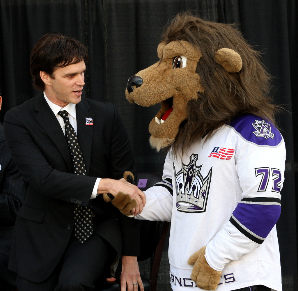 Luc Robitaille (L) of the Los Angeles Kings and  the Los Angeles Kings' mascot speak during the press conference celebrating the 10th anniversary for the Staples Center on October 21, 2009 in Los Angeles, California.