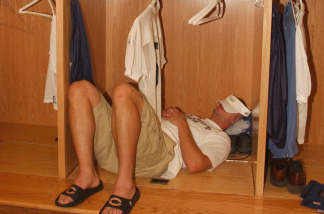 Linebacker Joe Odom #59 of the Chicago Bears takes a nap in his new locker during the media tour the locker room of the rebuilt Soldier Field stadium, home to the NFL Chicago Bears and the MLS Chicago Fire, on September 18, 2003 in Chicago, Illinois.