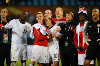 Landon Donovan of the United States (C) celebrates victory with team mates that sends the USA through to the second round in the 2010 FIFA World Cup South Africa Group C match between USA and Algeria