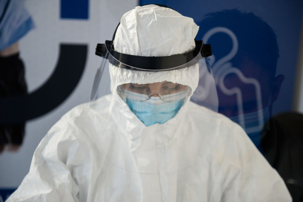 A health worker wears a protective mask and suit as she performs  an antibody test for COVID-19 at the Dworska Hospital on April 9, 2020 in Krakow, Poland.