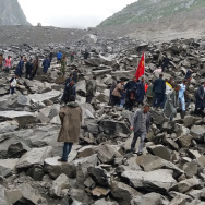 Chinese military police and rescue workers at the site of a landslide in in Xinmo village, Sichuan province on Saturday.