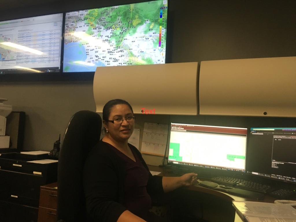 Los Angeles County Supervising Dispatcher Enma DeLeon is one of the people reached by phone when the public calls for help about mudslides, falling rocks and other local emergencies.