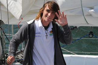 Zac Sunderland of the US waves as he arrives at Marina Del Rey, California, on July, 16, 2009. The 17 year old teenager became the youngest person to circumnavigate the world alone by yatcht.