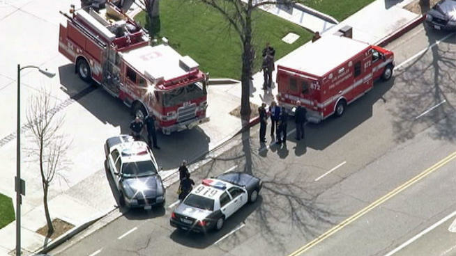 An ambulance and fire truck were at the scene in Woodland Hills on Wednesday, March 27, 2013, where a young girl was found who had been reported missing.