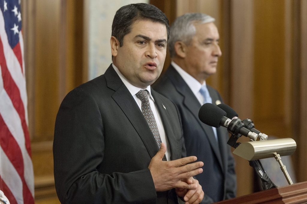 President of Honduras Juan Orlando Hernandez, left, delivers remarks on immigration beside President of Guatemala Otto Perez Molina.
