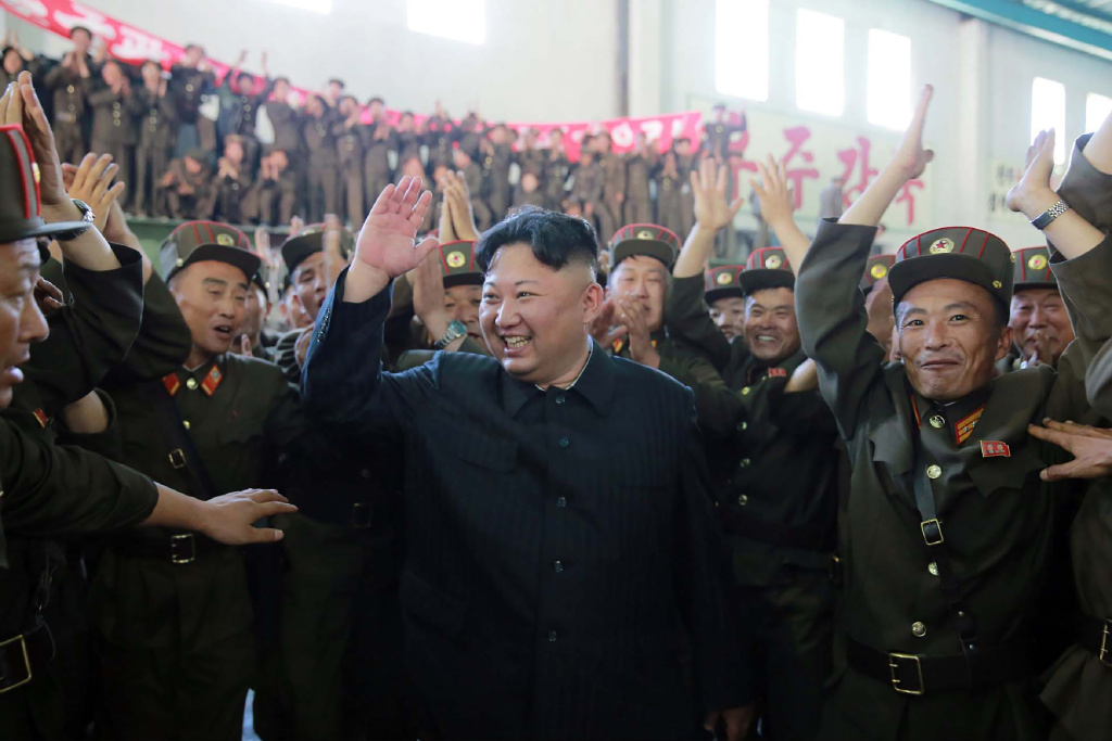 North Korean leader Kim Jong-Un (C) celebrating the successful test-fire of the intercontinental ballistic missile Hwasong-14 at an undisclosed location.
