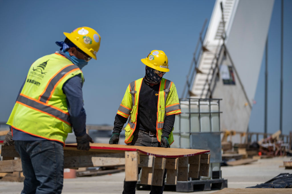 Construction workers work on the new Frederick Douglass Memorial Bridge on May 19, 2021 in Washington, DC.