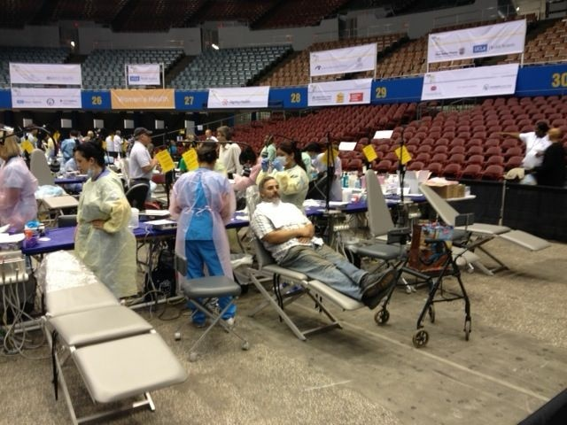 A patient receives complimentary dental care at last year's Care Harbor clinic.