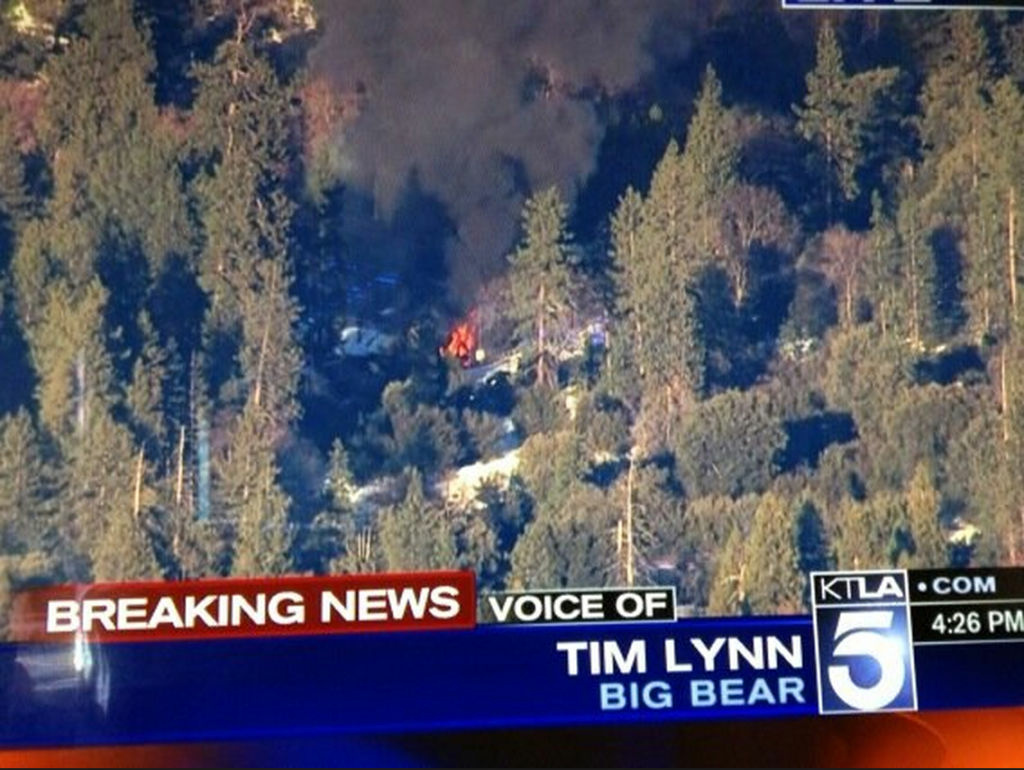 A screenshot showing a cabin on fire near Big Bear where police surrounded a man they believe to be murder suspect Christopher Dorner following two gun battles on Feb. 12, 2013. A deputy was killed in one of the battles.