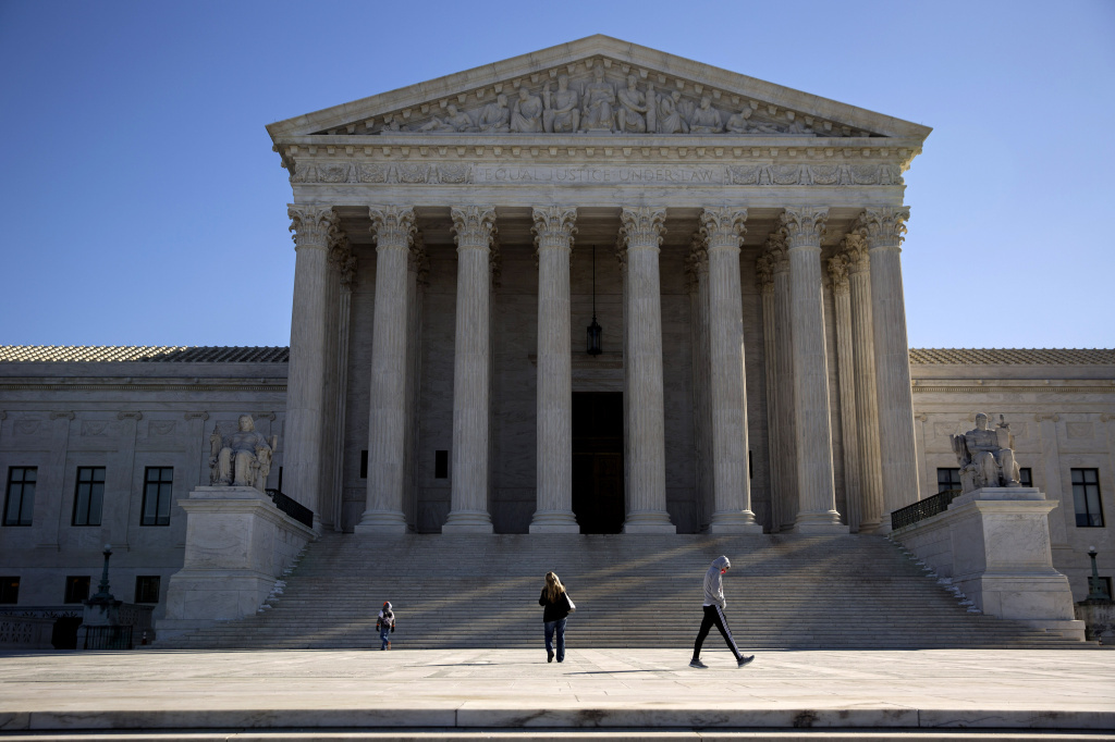 Visitors walk outside the U.S. Supreme Court on Feb. 14.
