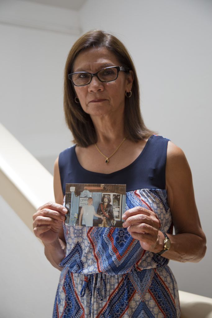 Lydia Nunez holds a photo of her son Ruben.